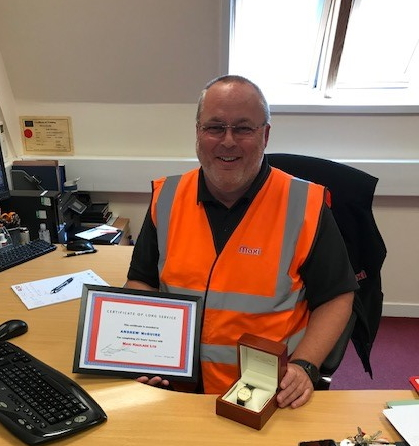 Andy McGuire 25 years service